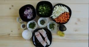 Seebarsch auf Gemüse gegart in Kochtüte von DirektNatur
